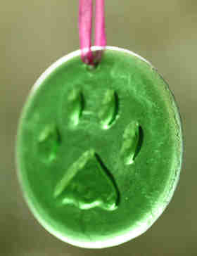 beer bottle paw print ornament with colored ribbon