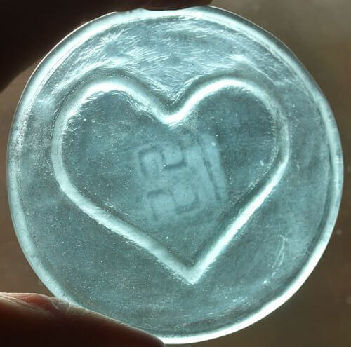 recycled glass heart roundel in aqua
